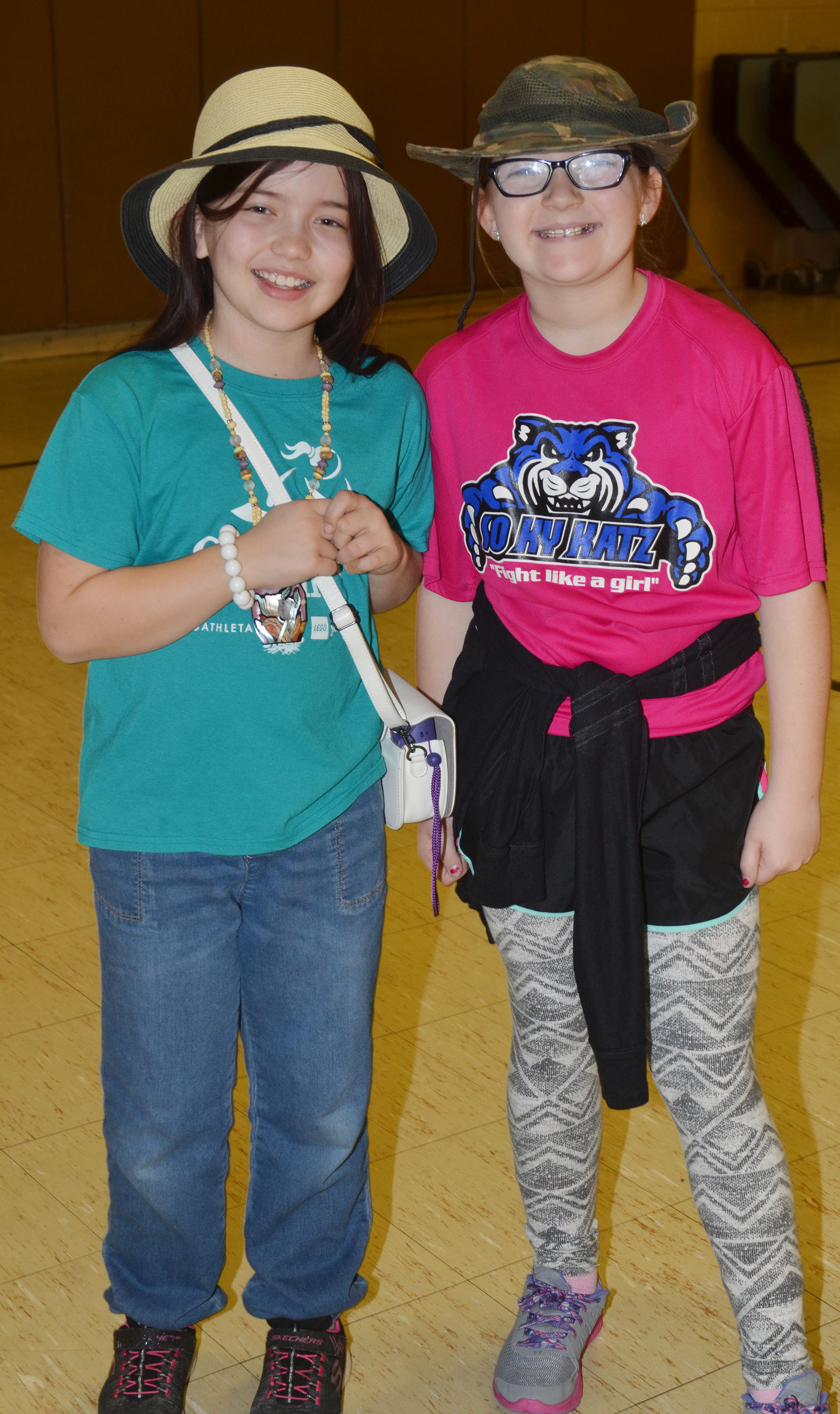 CMS fourth-graders Kate Billeter, at left, and Lilyan Muprhy dress for Tacky Tourist Day.