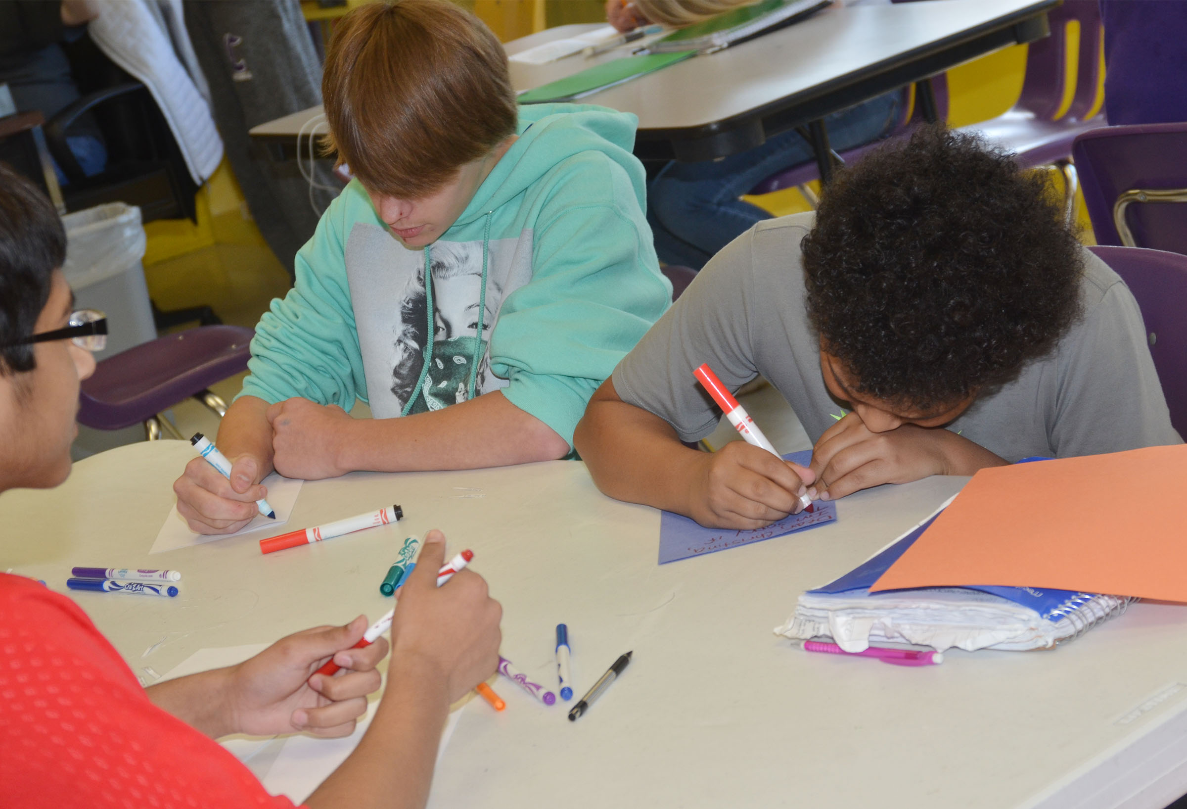 CMS eighth-graders Dalton Reynolds, at left, and Alex Lofton write good luck cards.