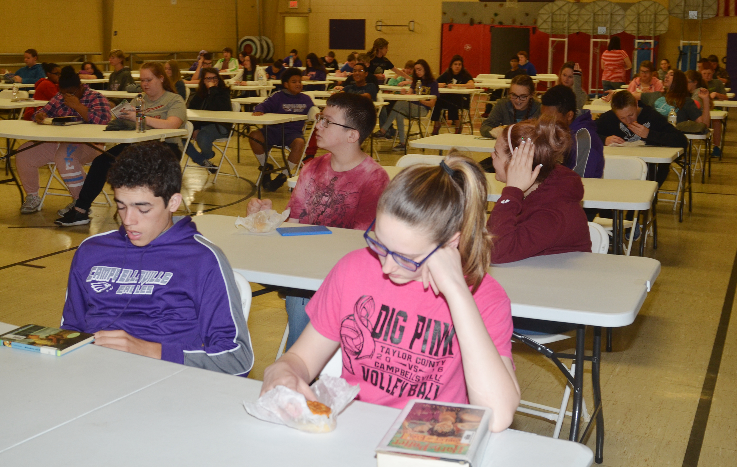 CMS eighth-grader Kameron Smith, at left, and Zoie Sidebottom enjoy sausage biscuits as they prepare to begin state testing.