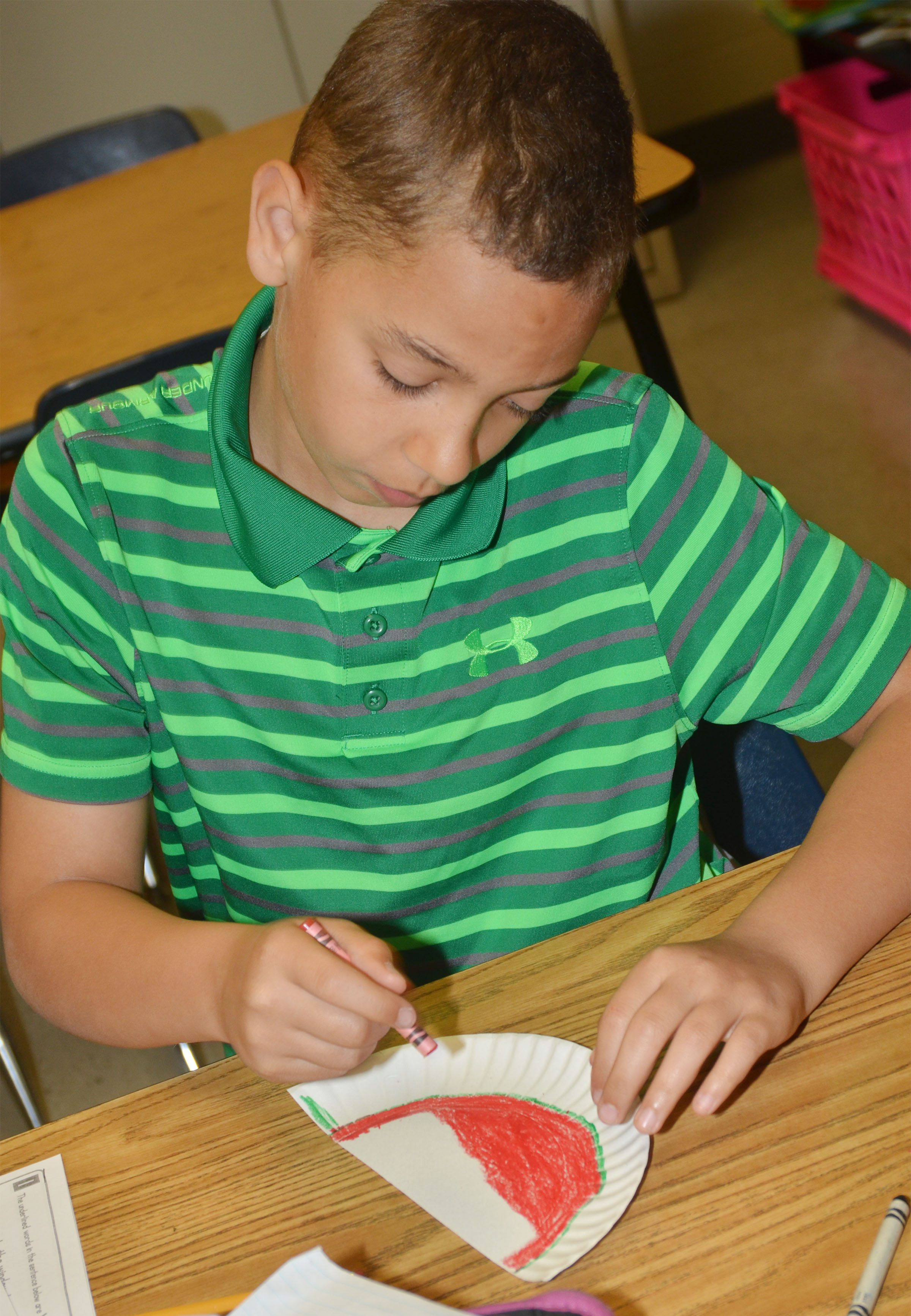 CMS fourth-grader Aiden Eastridge colors his watermelon.