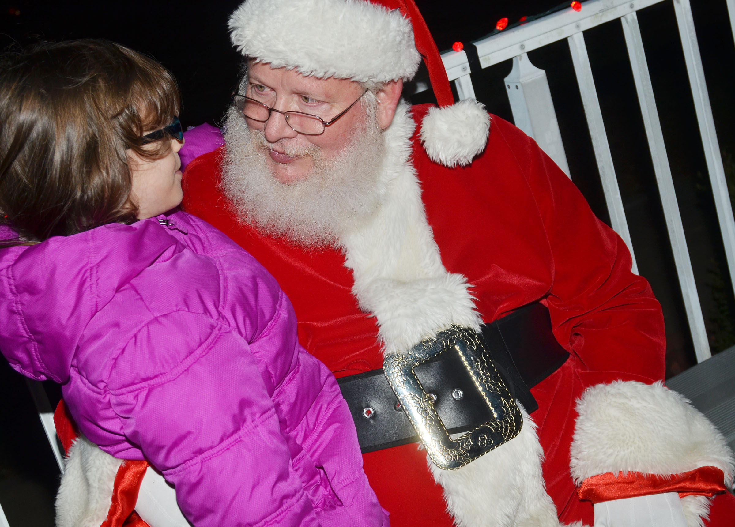 Campbellsville Elementary School second-grader Lilly Wise talks with Santa.