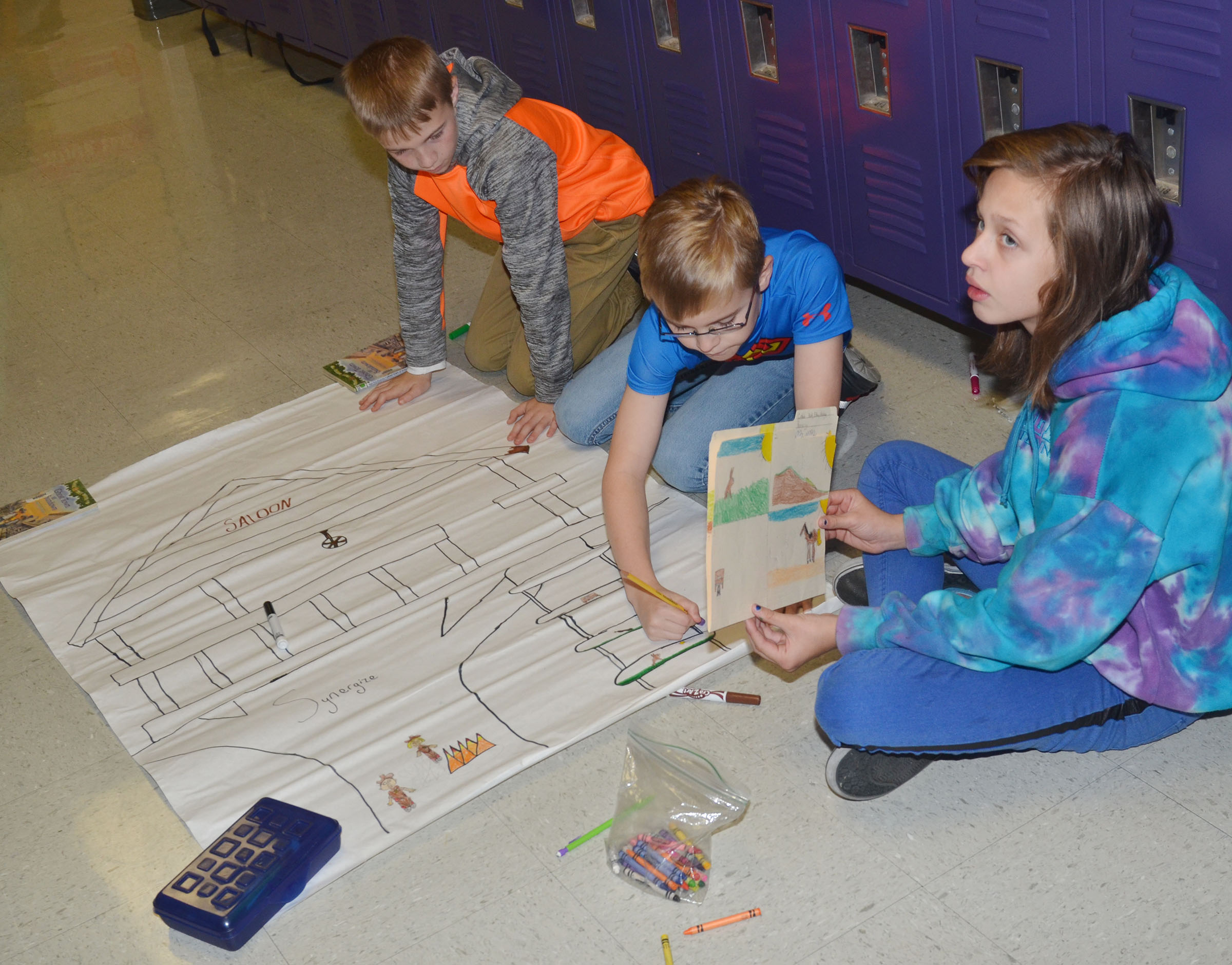 CMS fifth-graders, from left, Ethan Cox, Caleb Holt and Halley Wooley work on their treehouse project.