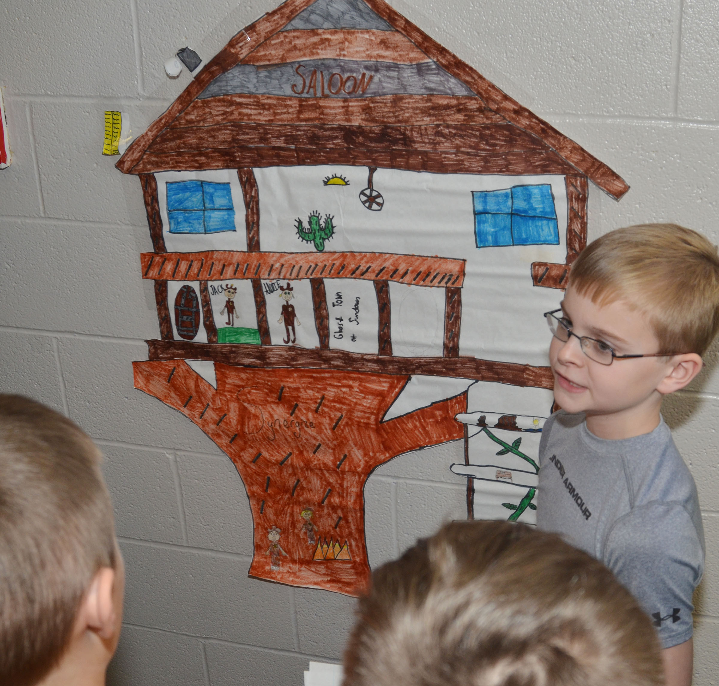 CMS fifth-grader Caleb Holt presents his group's treehouse project to fourth-graders.