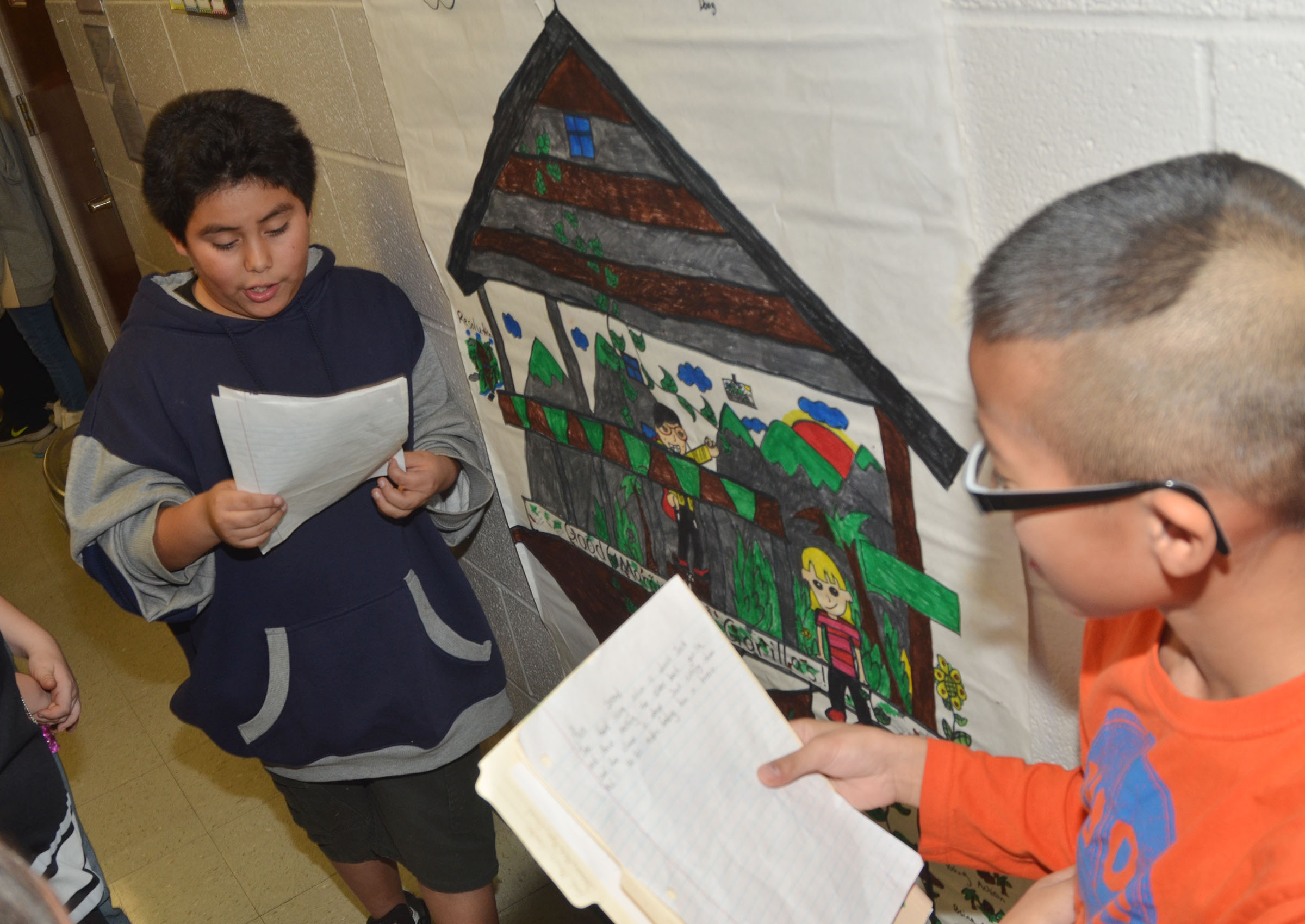 CMS fifth-graders Alex Martinez, at left, and Shawn Dong present their group's treehouse project.