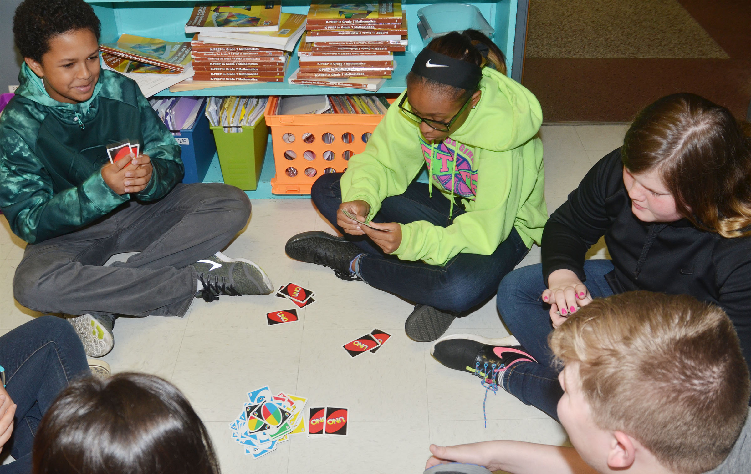 From left, CMS seventh-graders Tezon Mitchell, Bri Gowdy, Sumara Berry and Blake Settle play UNO.