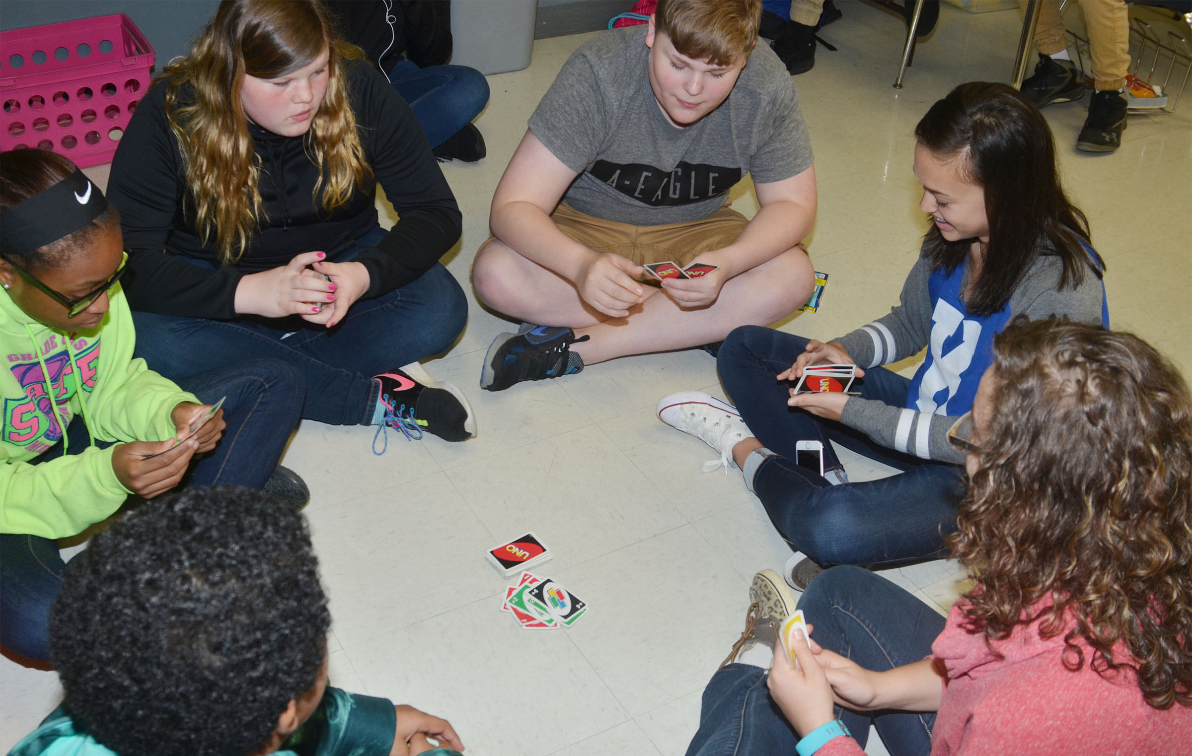 CMS seventh-graders, from left, Bri Gowdy, Sumara Berry, Blake Settle and Tayler Thompson play UNO with student teacher Jessica Hogue.