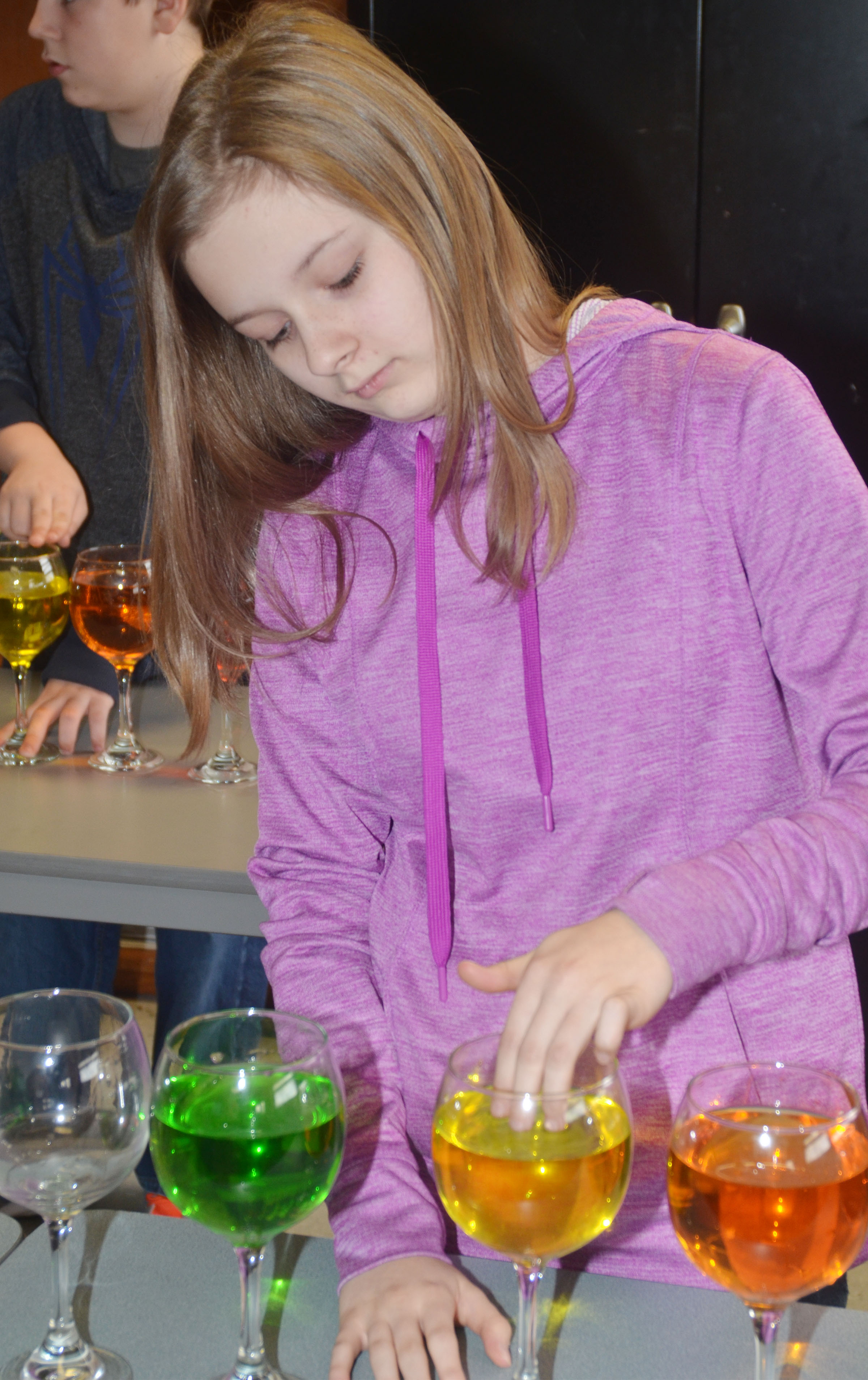 CMS seventh-grader Serenity Ford plays the water glasses.