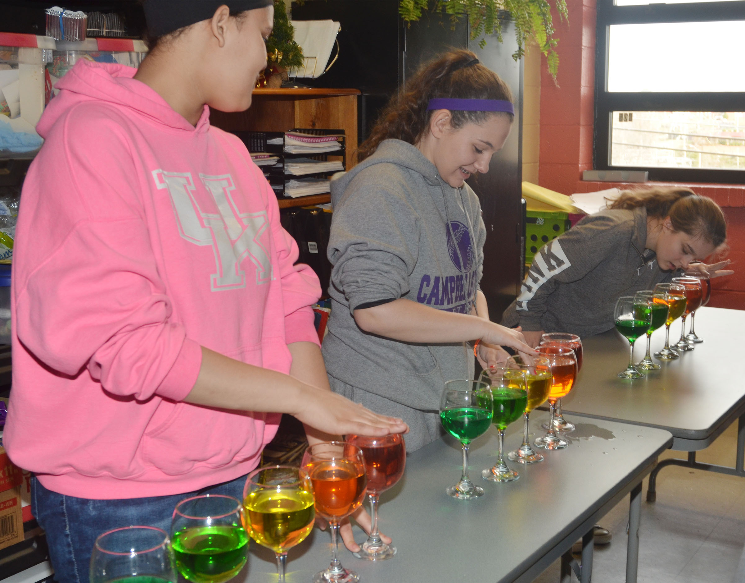 From left, CMS eighth-graders Jasmine Francis, Kaylee Reynolds and Chloe Bennett play the water glasses.