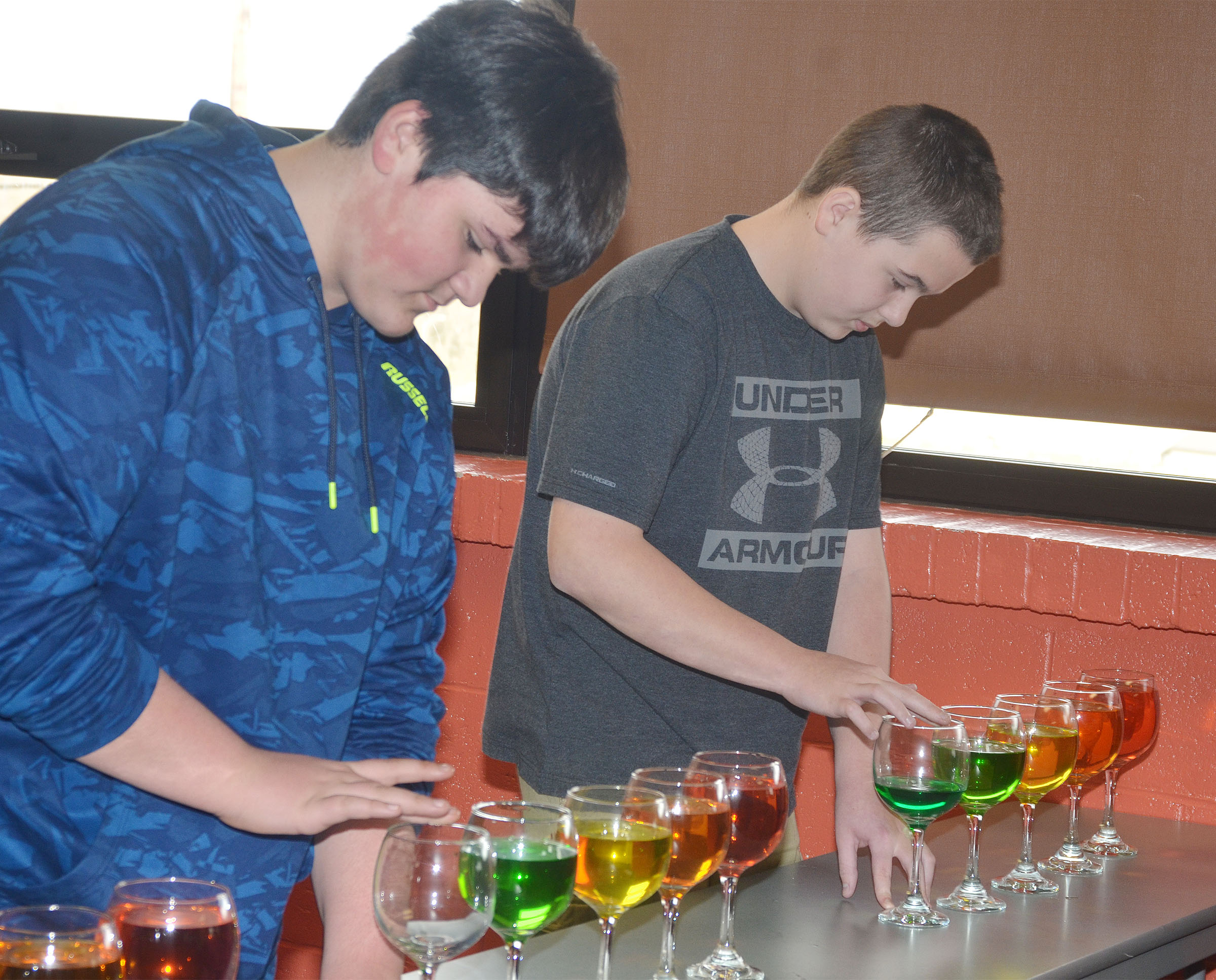 CMS seventh-graders Logan Rakes, at left, and Jack Sabo play the water glasses.