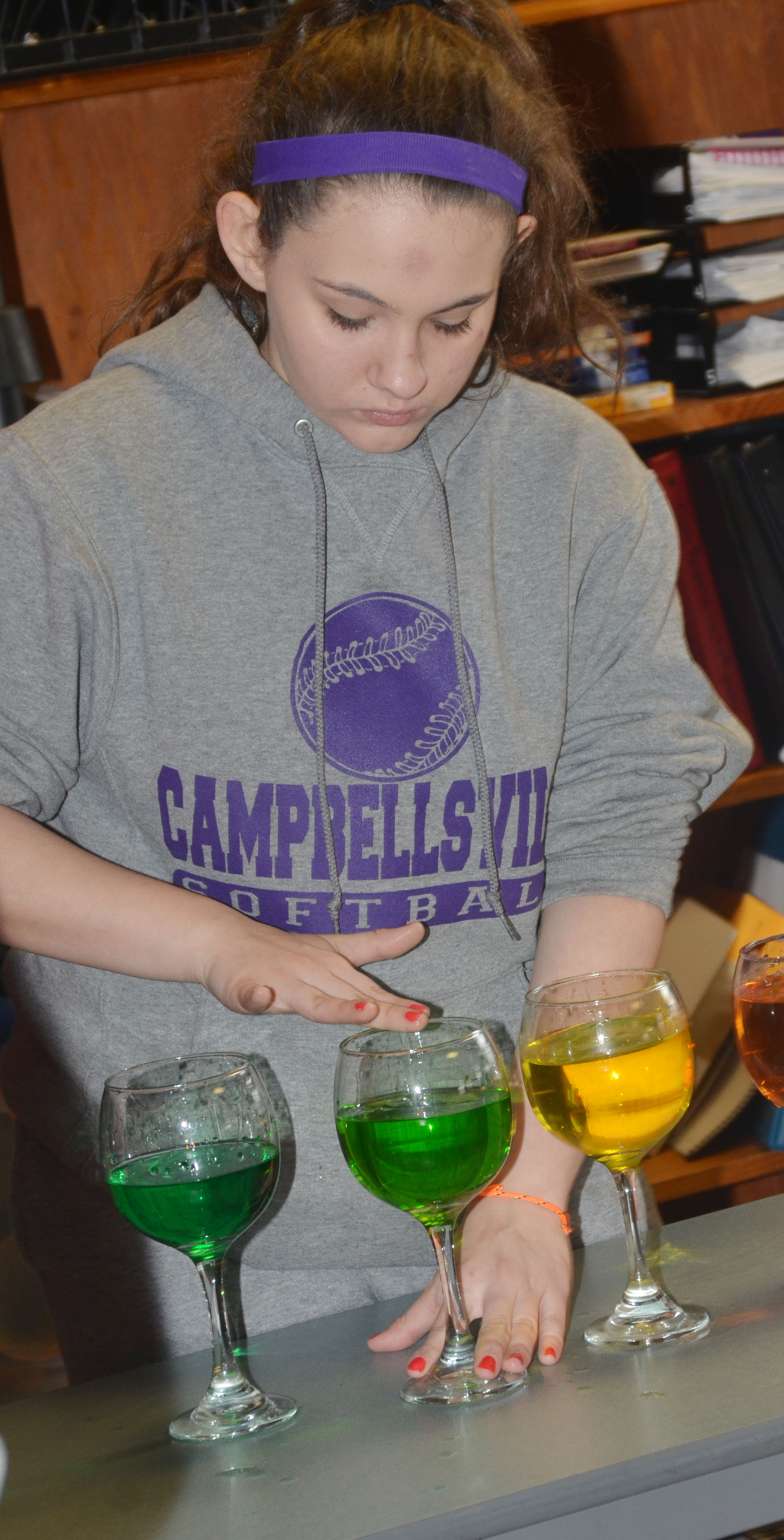 CMS eighth-grader Kaylee Reynolds plays the water glasses.
