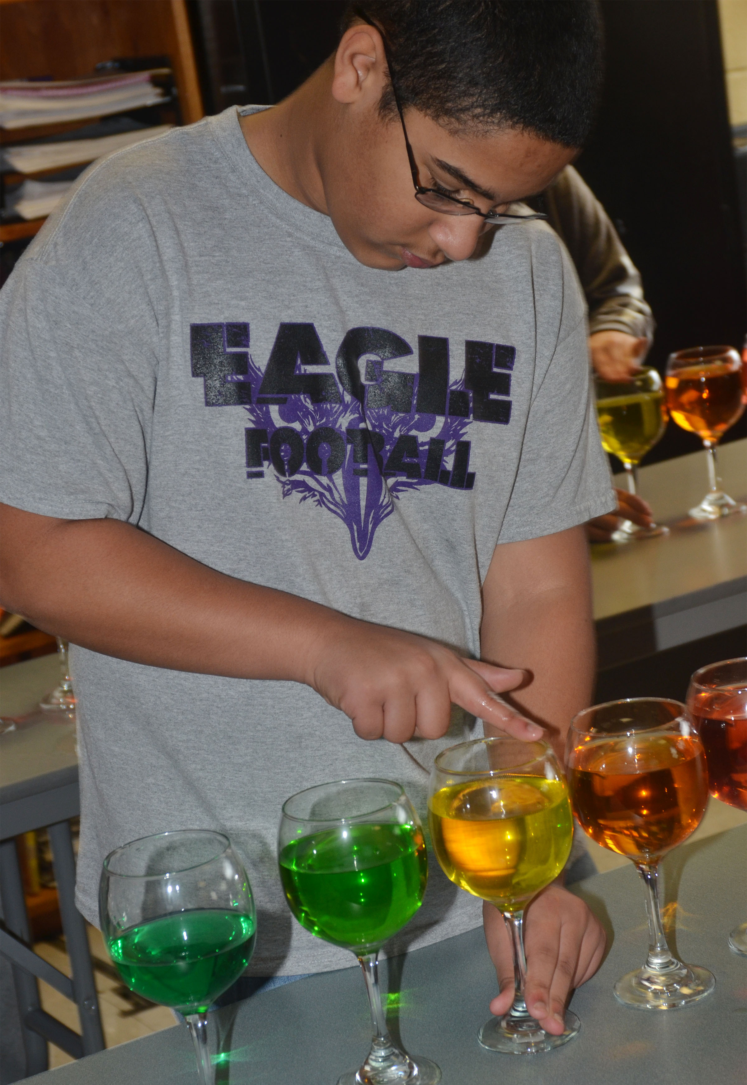 CMS eighth-graders Tyreece Washington plays the water glasses.
