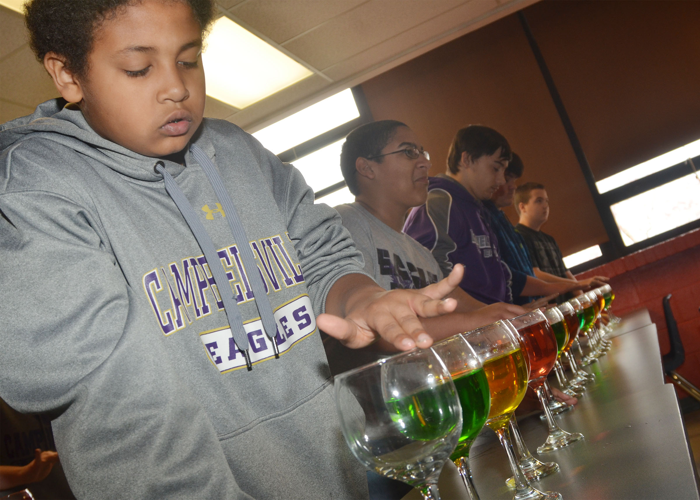 CMS sixth-grader Ronin Smith plays the water glasses.