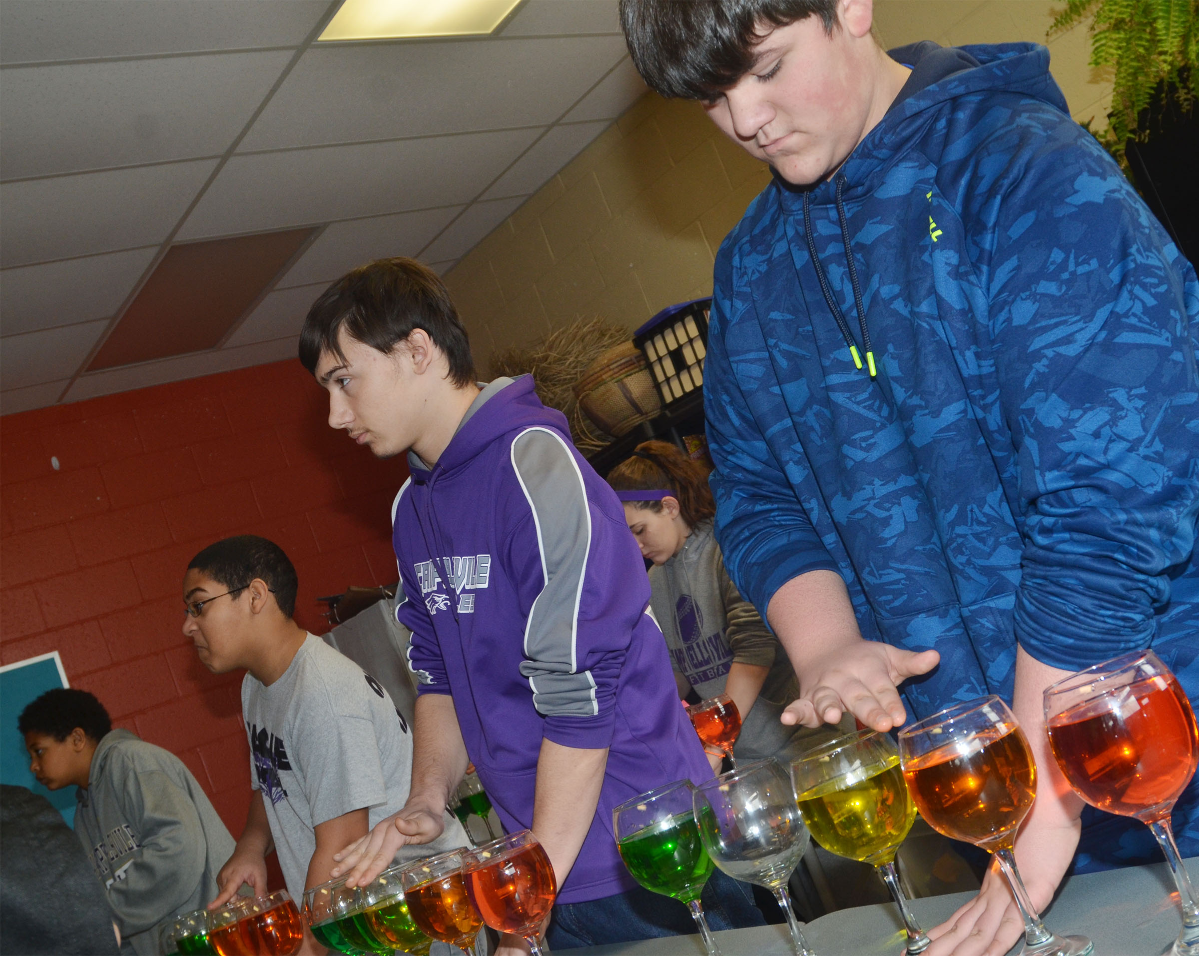 CMS seventh-grader Logan Rakes and his classmates play the water glasses.