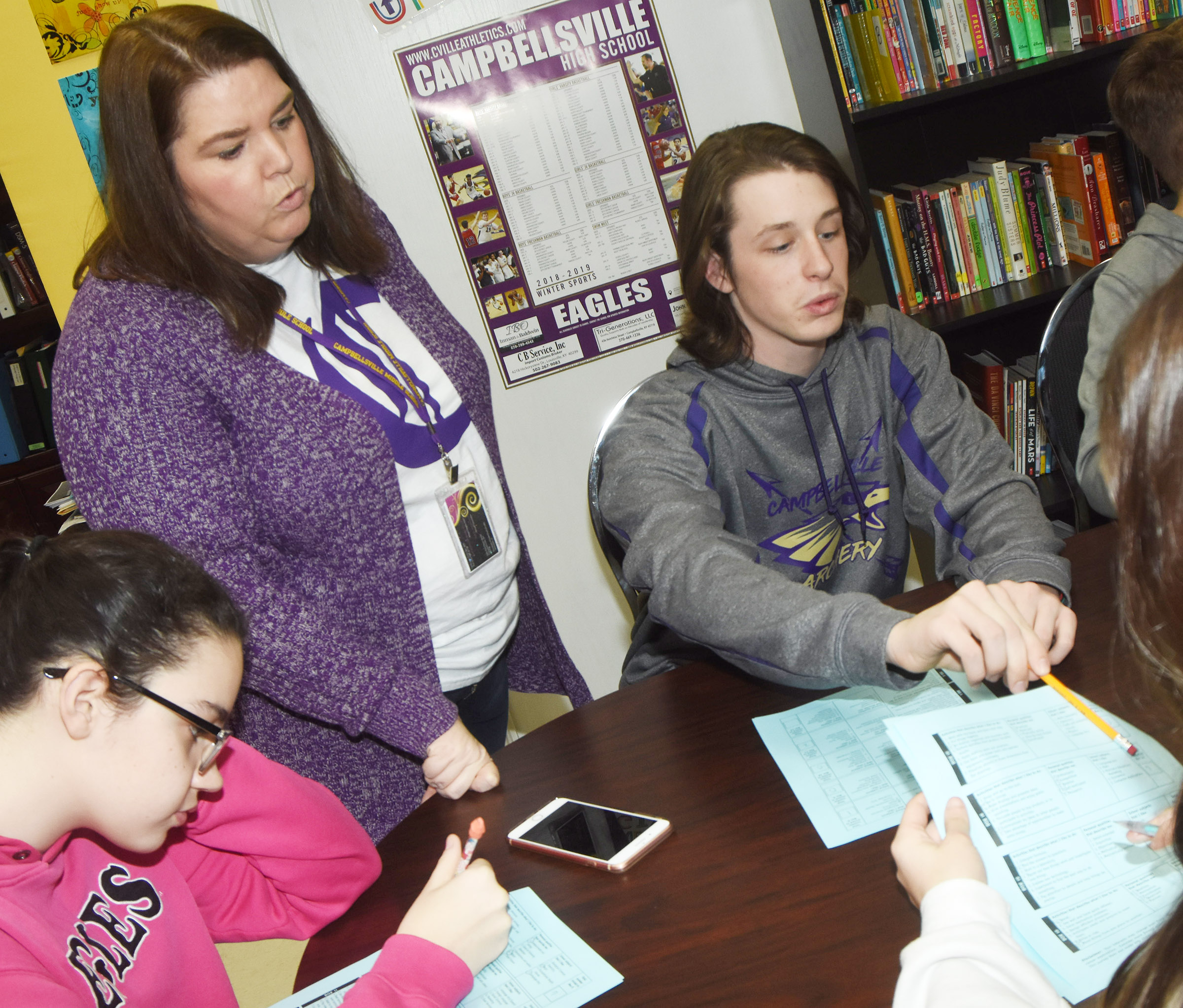 CMS Guidance Counselor Beth Wiedewitsch talks to eighth-graders Mary Russell, at left, and Seth Hash about their career quizzes.