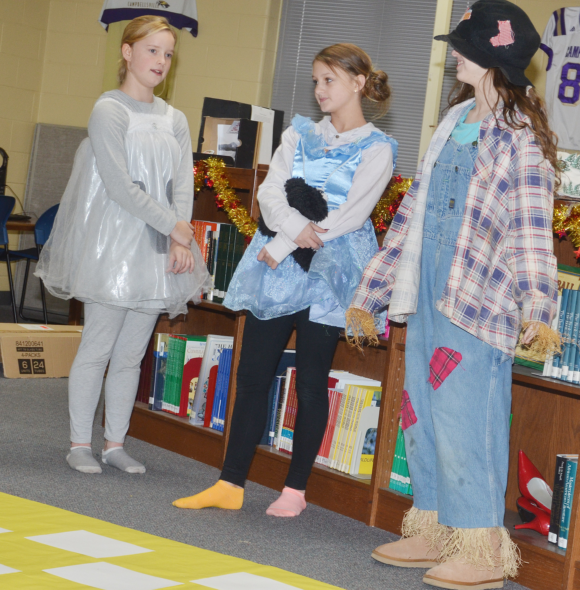 From left, CMS seventh-graders Tonya Parker is Tin Girl, Alexis Byers is Dorothy and Karlee Rakel is Scarecrow.