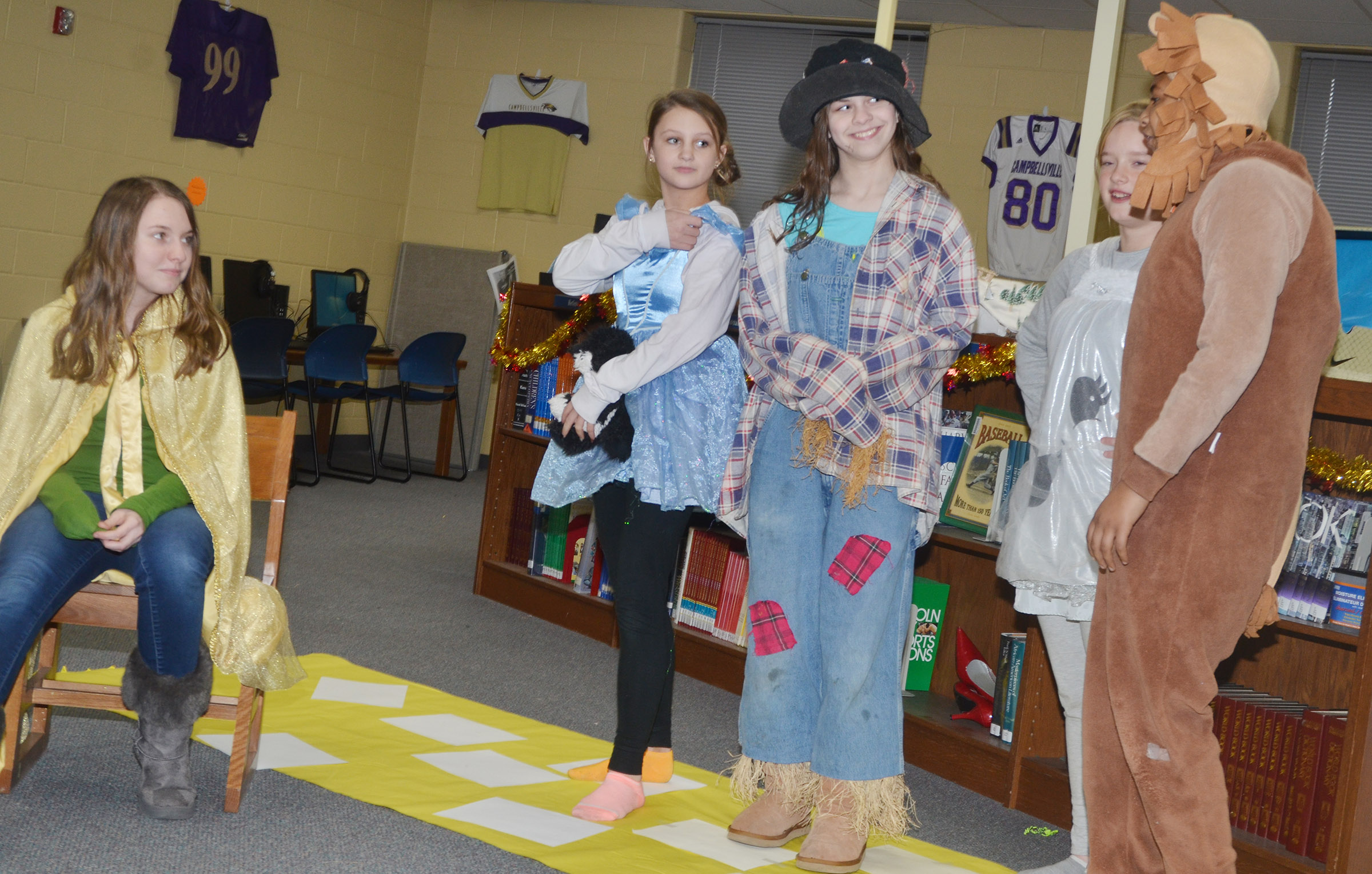 "CMS seventh-graders present ""The Wizard of Oz."" From left are Leigh Hicks as the Wizard, Alexis Byers as Dorothy, Karlee Rakel as Scarecrow, Tonya Parker as Tin Girl and Ronin Smith portraying the Lion."