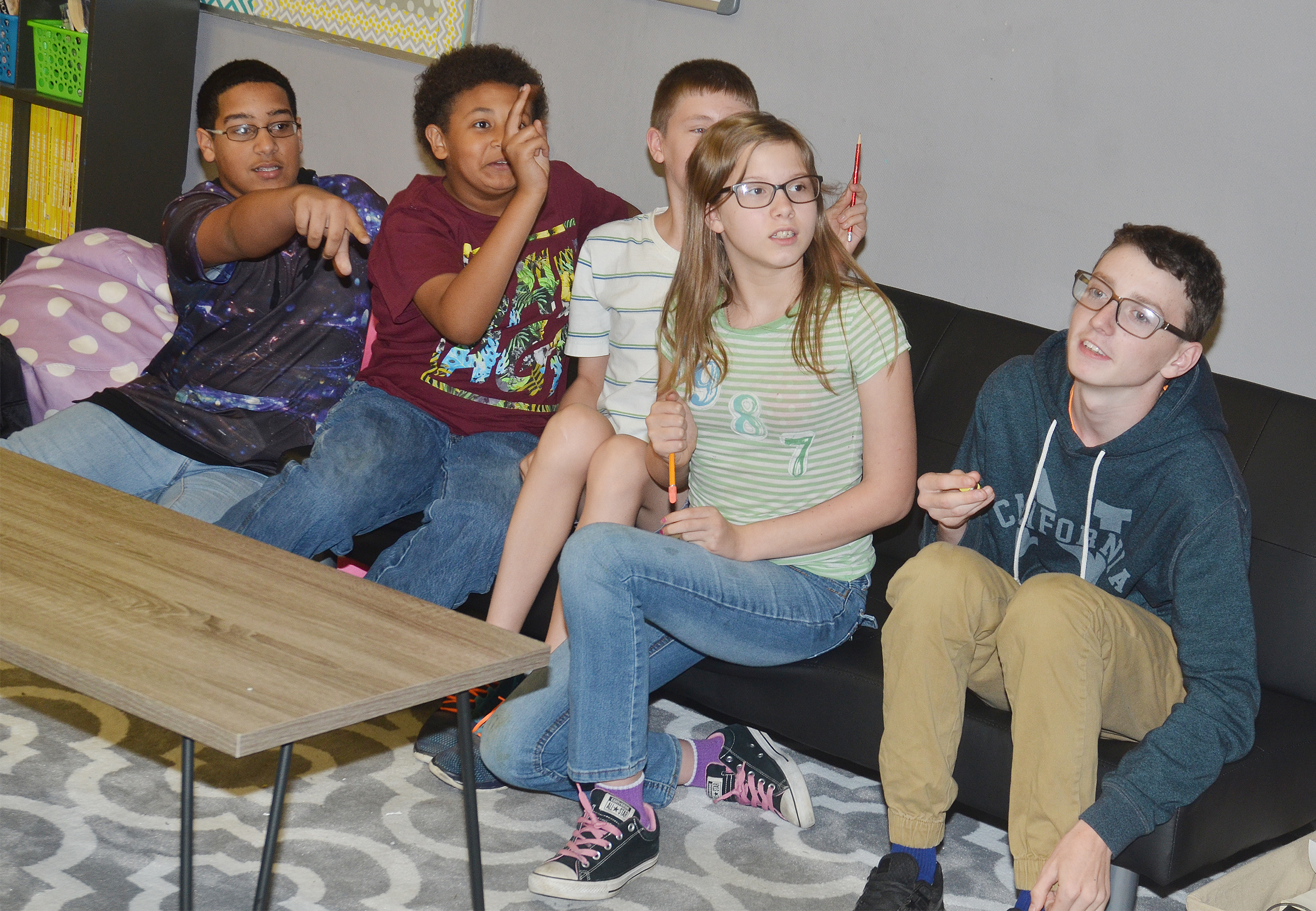 From left, CMS eighth-grader Tyreece Washington, sixth-graders Ronin Smith, Blake Tungate and Forever Tungate and eighth-grader Jonathan Sparks talk about a question.