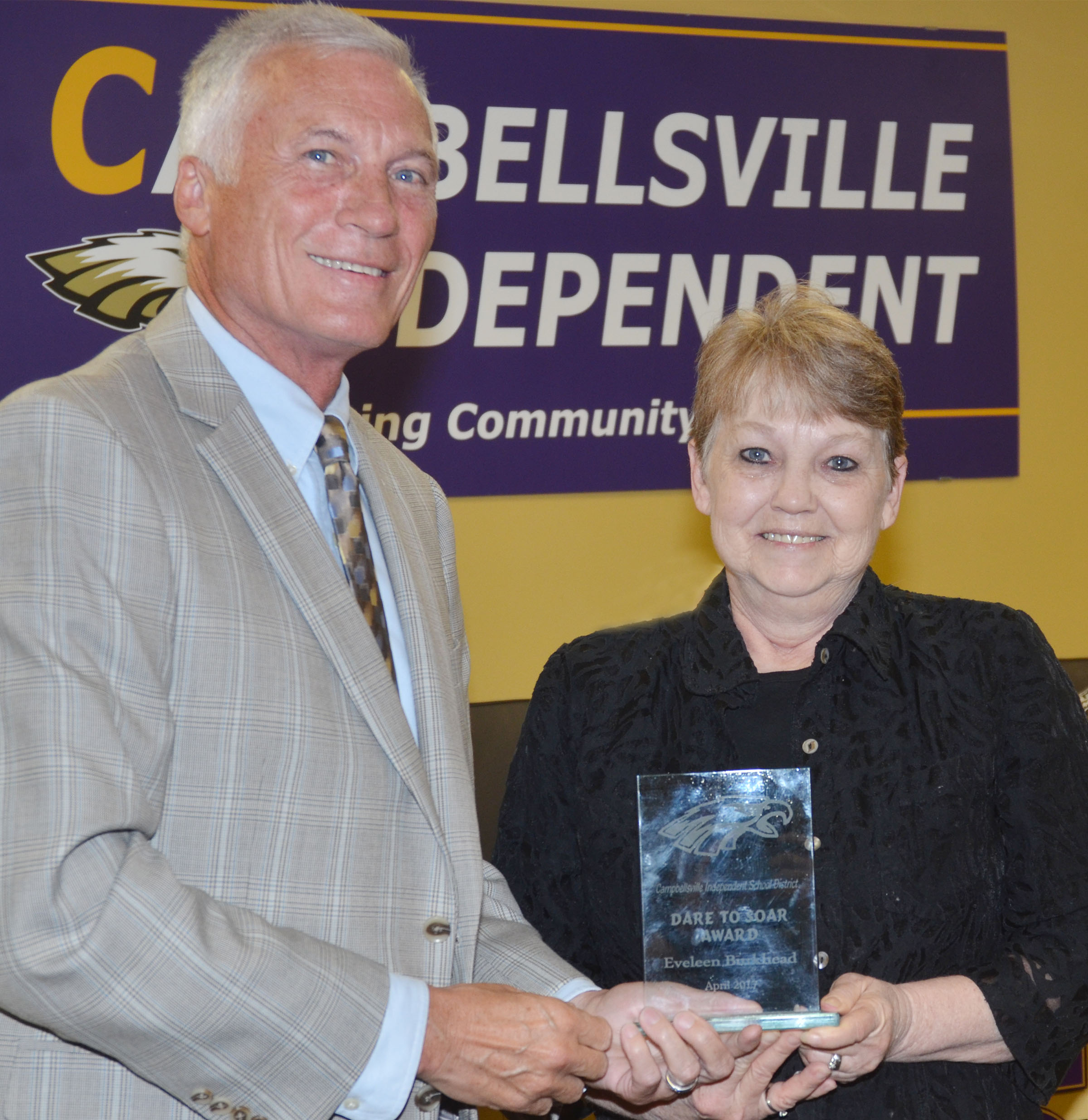 Campbellsville Elementary School cafeteria worker Eveleen Burkhead received this month's Dare to Soar award from Campbellsville Independent Schools Superintendent Mike Deaton.