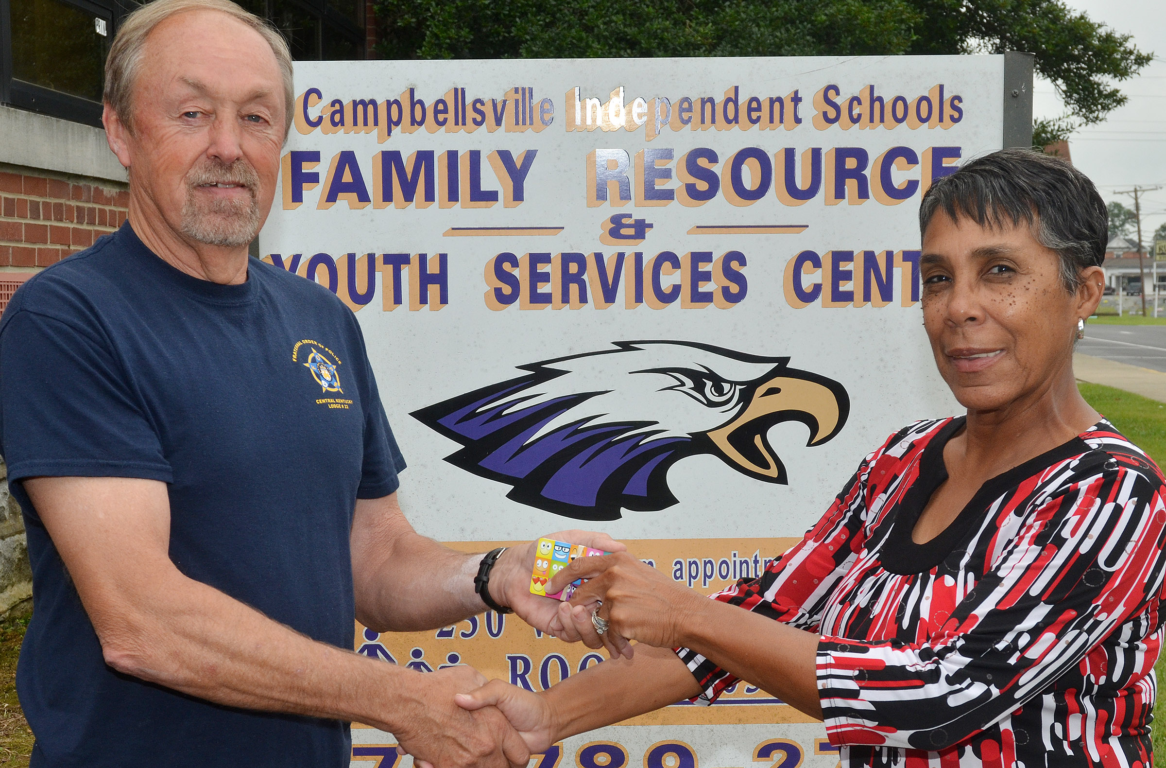 Central Kentucky Fraternal Order of Police Lodge #22 recently donated $1,500 to Campbellsville Family Resource and Youth Services Center, to benefit Campbellsville Independent Schools' students. FOP President Rick Benningfield, at left, made the donation to FRYSC assistant Sharon Hoskins Sanders.