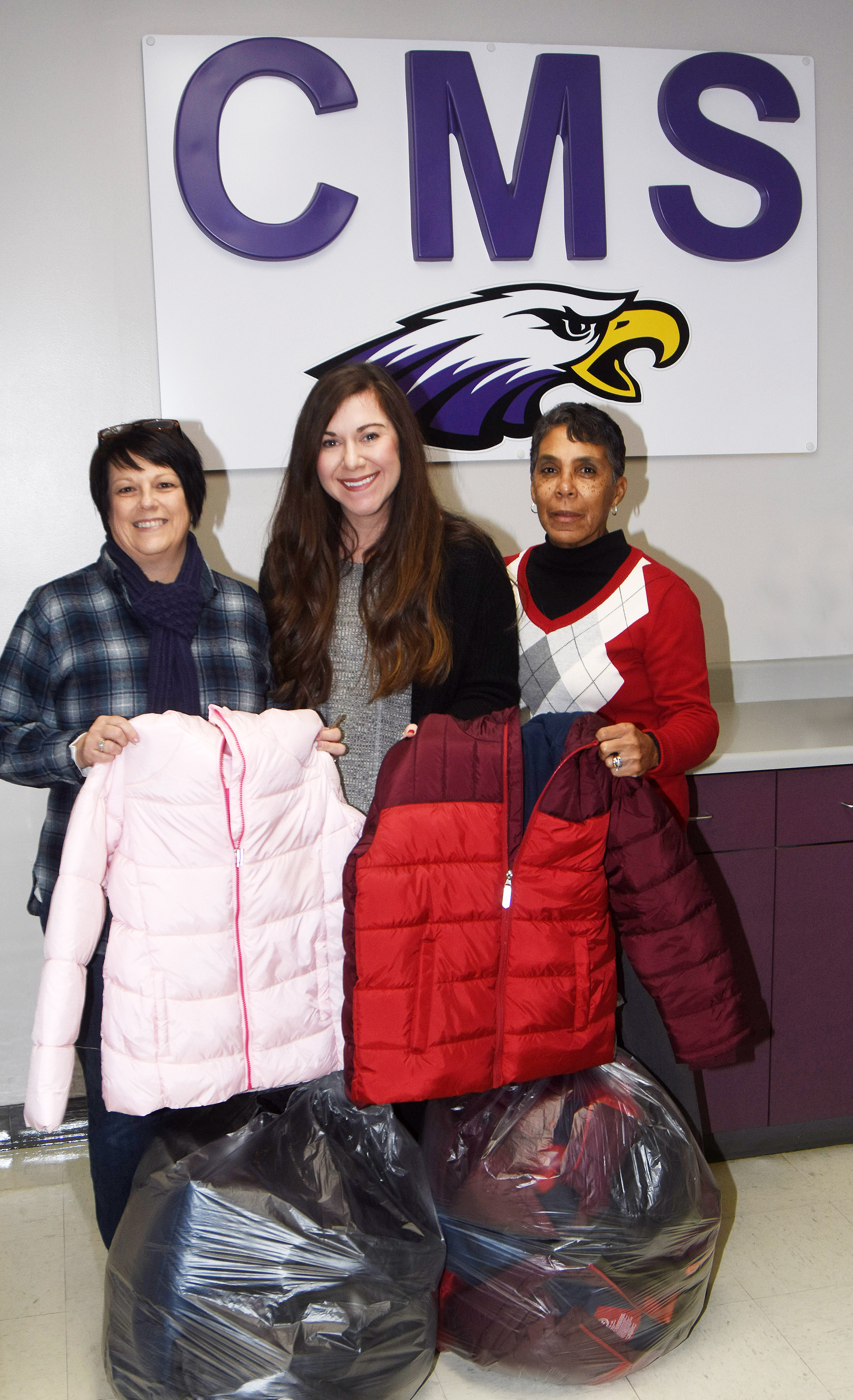On behalf of the Campbellsville Kiwanis Club, member Patricia Sprowles, at left, recently donated several coats to Campbellsville elementary and middle school students. Receiving the coats were Campbellsville Family Resource and Youth Services Center Director Courtney Sowell, center, and assistant Sharon Hoskins-Sanders.